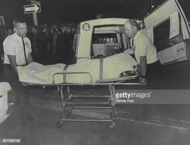 Ambulance attendants Arthur Barker leftand Gary Decker move body A Texas man was fatally shot by a Denver Policeman in 17th St night spot Credit...