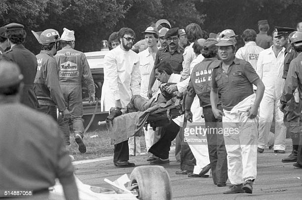 Ambulance attendants carry the body of Ronnie Peterson of Sweden from the track after he was injured in a fiery crash on the first turn of te Italian...