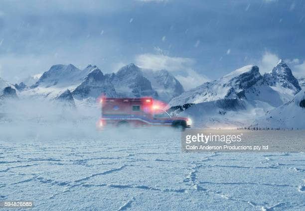 Ambulance driving in snowy remote landscape