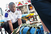Ambulance medics moving victim on stretcher