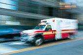ambulance speeding in New York City, blurred motion