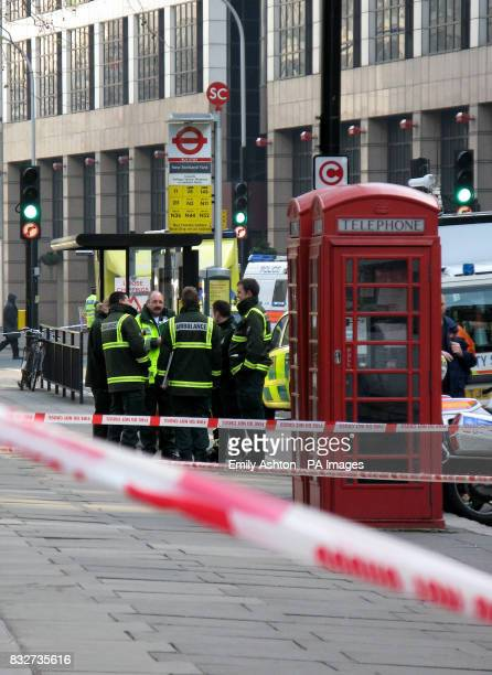 Ambulance staff at Victoria Street in central London where a letter bomb exploded at an office less than a mile from the Houses of Parliament