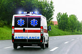 Ambulance van with flashing lights blured motion