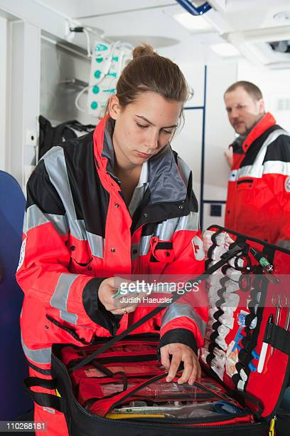 Ambulance woman in coach, preparing
