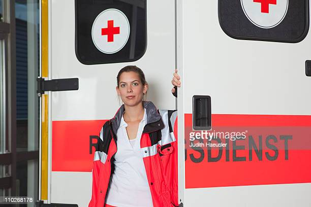 Ambulance woman in front of coach
