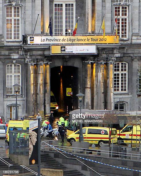 Ambulances and police are parked on the Place SaintLambert in Liege as a medical team arrives in the area after a gunman attack on December 13 2011 A...