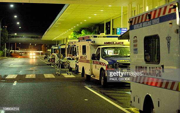Ambulances are lined up outside the International Terminal as hospitals are being evacuated to Brisbane ahead of Cyclone Yasi at Cairns Airport on...