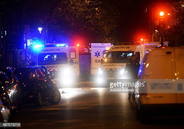 Ambulances are parked near the Bataclan concert hall after an attack on November 13 2015 in Paris France According to reports over 150 people were...