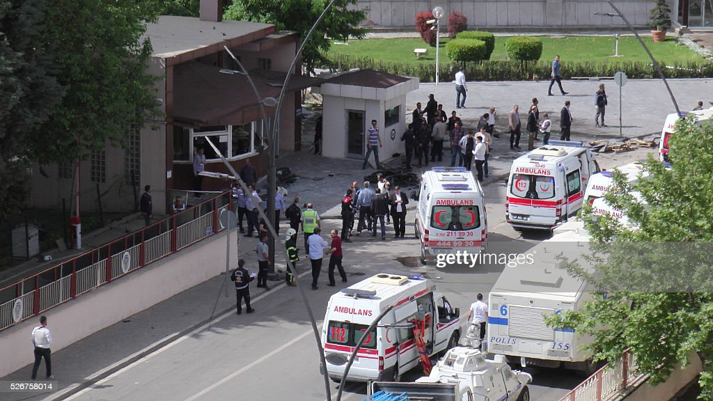 Ambulances are parked outside the police headquarters in the southeastern Turkish city of Gaziantep on May 1, 2016 after a bomb exploded, killing one police officer. A bomb exploded on May 1 outside police headquarters in the southeastern Turkish city of Gaziantep close to the Syrian border, killing one police officer and wounding 13 other people, the local governor said. Gaziantep regional governor Ali Yerlikaya was quoted by Turkish media as saying nine of those wounded were police. NTV television said the explosion was caused by a car bomb and had been followed by sounds of gunfire. AGENCY / - / Turkey OUT