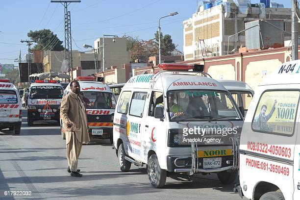 Ambulances are seen in Quetta Pakistan on October 25 after militants attacked the training college At least 61 cadets and guards were killed and more...