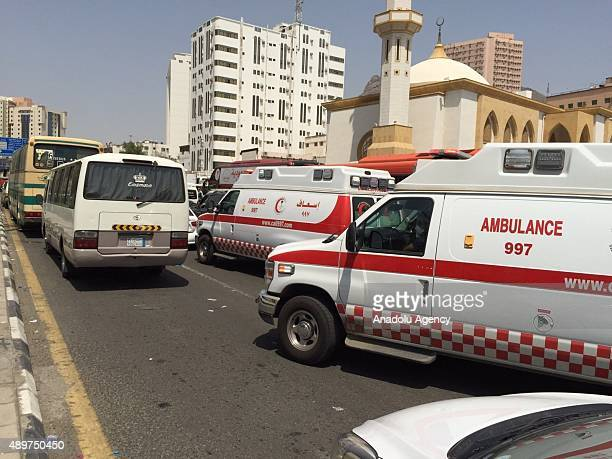 Ambulances are seen on a road after at least 310 Hajj pilgrims were killed and another 450 injured in a stampede that took place near the city of...