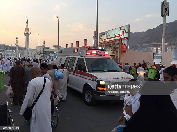 Ambulances are seen on a road after at least 753 Muslim Hajj pilgrims were killed and at least another 450 injured in a stampede that took place near...
