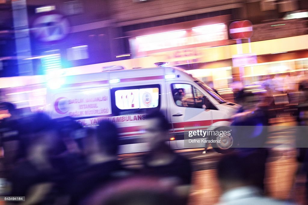 Ambulances arrives as relatives of the Ataturk Airport suicide bomb attack victims wait outside Bakirkoy Sadi Konuk Hospital, in the early hours of June 29, 2016 in Istanbul, Turkey. Three suicide bombers opened fire before blowing themselves up at the entrance to the main international airport in Istanbul, killing at least 31 people and wounding 147 people according to Justice Minister Bekir Bozdag.