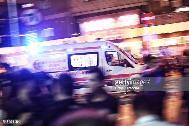 Ambulances arrives as relatives of the Ataturk Airport suicide bomb attack victims wait outside Bakirkoy Sadi Konuk Hospital in the early hours of...