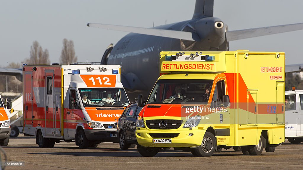 Ambulances arrives at the Airport Berlin Tegel on March 12, 2014 in Berlin, Germany. Germany is providing medical aid for Ukranian citizens who were seriously injured in the course of the violent escalation of the protests on the Maidan in Kiev. 12 patients will then be transferred to the Bundeswehr Hospital Berlin, Charite Hospital and the private hospital operator Vivantes. Another six patients each will be taken up by the Bundeswehr Hospital Ulm and the Bundeswehr Central Hospital in Koblenz.