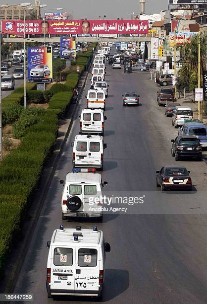Ambulances carrying the bodies of 34 Lebanese who drowned in the waters of Indonesia depart from the Rafik Hariri International Airport on October 31...