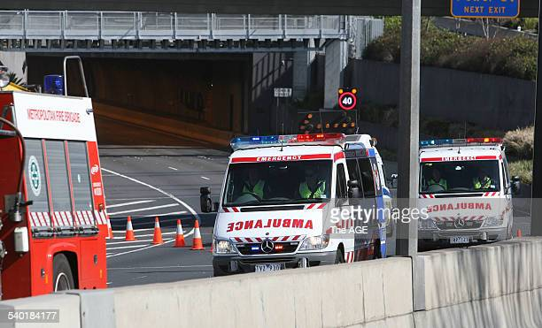 Ambulances leave the entrance of the Citylink Burnley after a multiple car pile up sparked a blaze the reached more than 1000 degrees killing three...