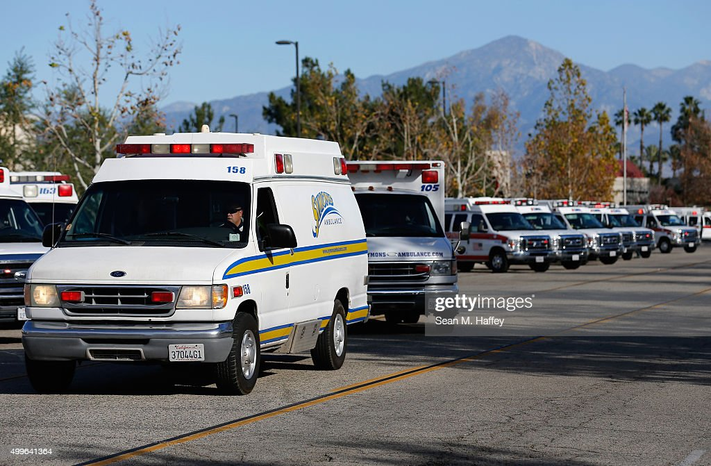 Ambulances pull out of a staging area near the Inland Regional Center where a shooting occurred earlier in the day on December 2 2015 in San...