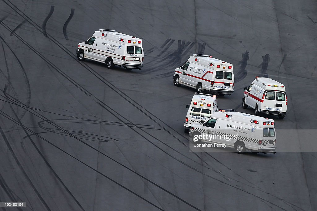 Ambulances sit on the track after emergency officials responded to an incident at the finish of the NASCAR Nationwide Series DRIVE4COPD 300 at Daytona International Speedway on February 23, 2013 in Daytona Beach, Florida.