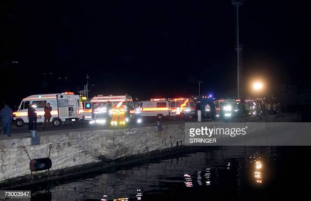 Ambulances wait for the people injured in the collision between a merchant ship and a hydrofoil ferry to arrive at the port of Reggio di Calabria 15...