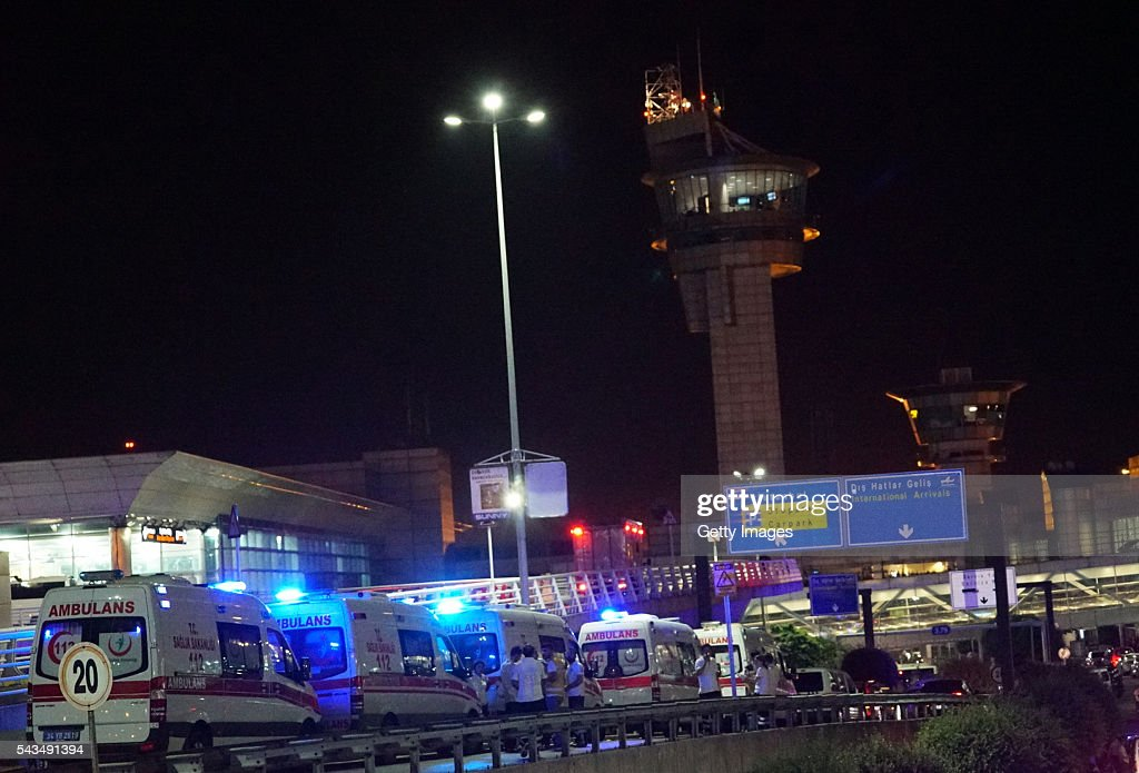 Ambulances wait outside Turkey's largest airport, Istanbul Ataturk, on June 28, 2016 in Istanbul, Turkey. Three suicide bombers opened fire before blowing themselves up at the entrance to the main international airport in Istanbul, killing at least 28 people and wounding at least 60 people, according to Istanbul governor Vasip Sahin.