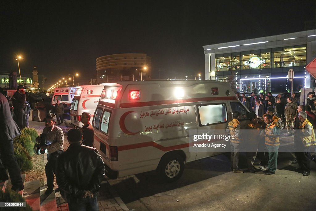 Ambulances wait ready after a fire incident broke out at a massage center of Capitol Hotel in Erbil, Iraq on February 6, 2016. At least 19 people have been killed and dozens have been injured in a hotel fire in the capital of Iraq's.