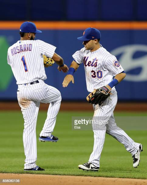 Amed Rosario and Michael Conforto of the New York Mets celebrate the 42 win over the against the Arizona Diamondbacks on August 23 2017 at Citi Field...