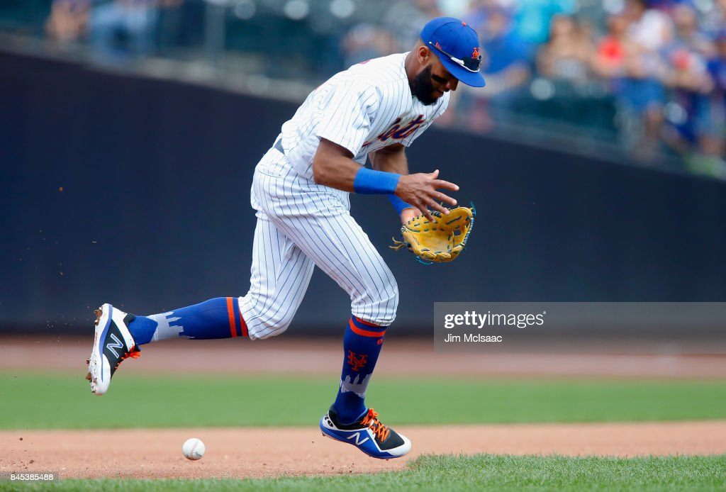 Amed Rosario #1 of the New York Mets can't come up up with a ball hit for an infield single in the fourth inning by Scott Schebler #43 of the Cincinnati Reds at Citi Field on September 10, 2017 in the Flushing neighborhood of the Queens borough of New York City.