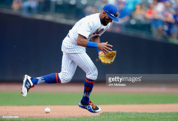 Amed Rosario of the New York Mets can't come up up with a ball hit for an infield single in the fourth inning by Scott Schebler of the Cincinnati...