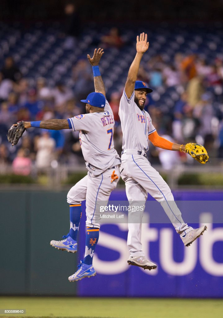 Amed Rosario #1 of the New York Mets celebrates with Jose Reyes #7 at the end of the game against the Philadelphia Phillies at Citizens Bank Park on August 11, 2017 in Philadelphia, Pennsylvania. The Mets defeated the Phillies 7-6.