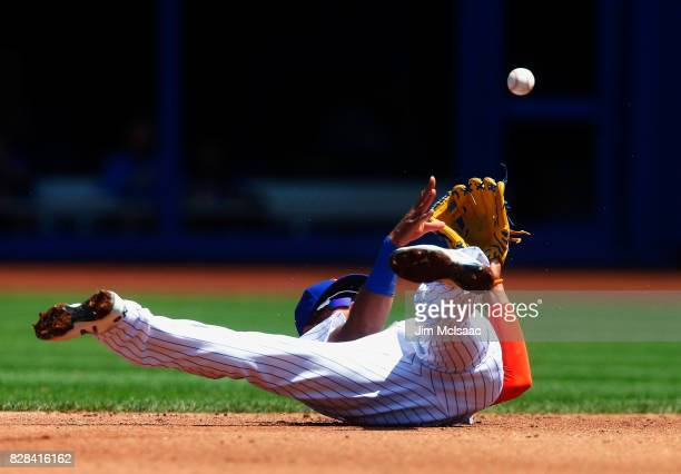 Amed Rosario of the New York Mets flips the ball to second base for an out against the Texas Rangers during the second inning at Citi Field on August...