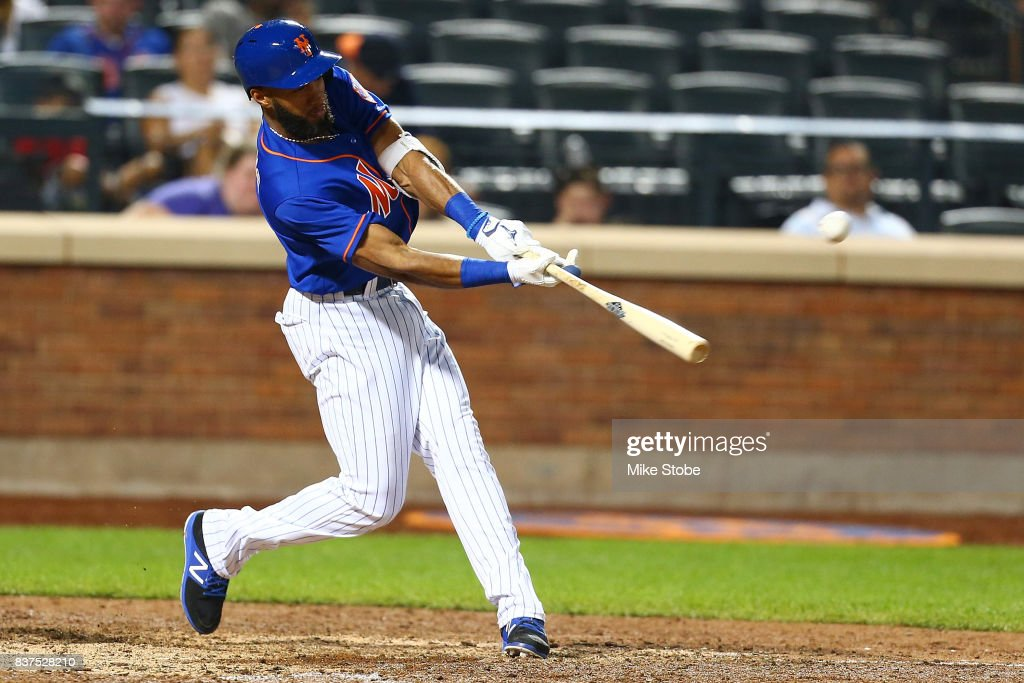 Amed Rosario #1 of the New York Mets hits a RBI triple in the ninth inning against the Arizona Diamondbacks at Citi Field on August 22, 2017 in the Flushing neighborhood of the Queens borough of New York City.