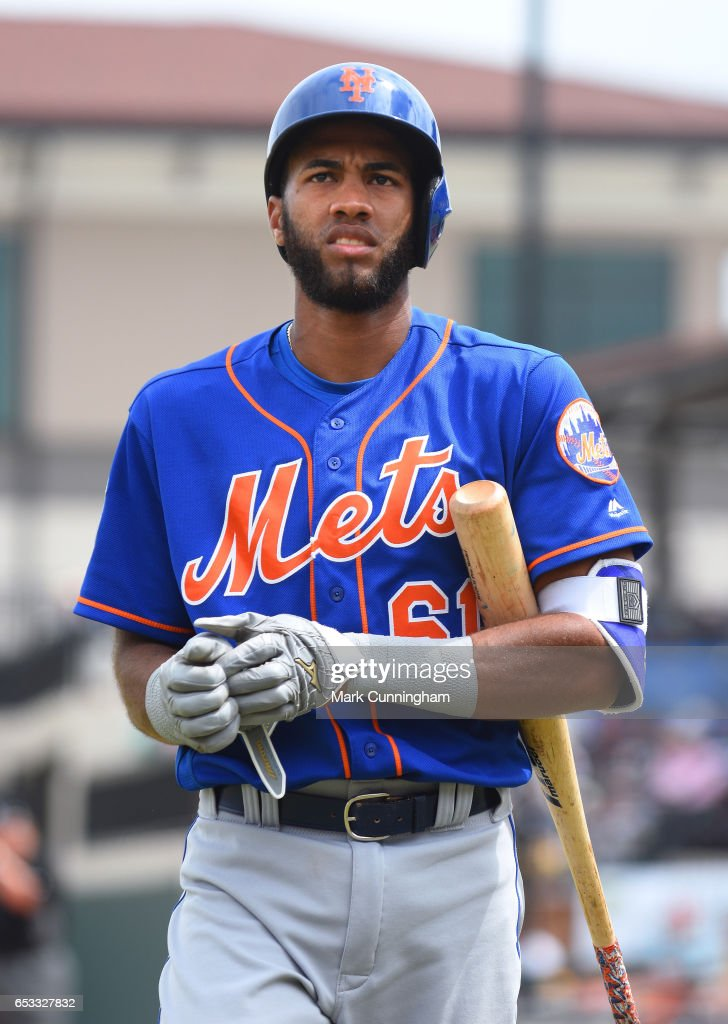 Amed Rosario #61 of the New York Mets looks on during the Spring Training game against the Detroit Tigers at Publix Field at Joker Marchant Stadium on March 12, 2017 in Lakeland, Florida. The Tigers defeated the Mets 4-3.