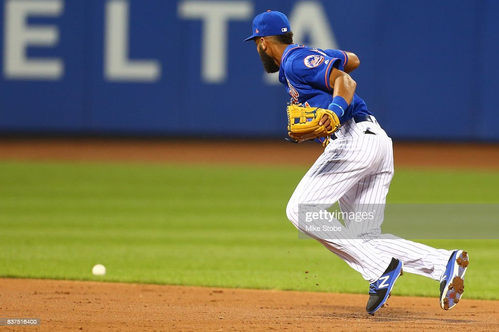 Amed Rosario #1 of the New York Mets makes an error in the third inning to allow a run to score during the game against the Arizona Diamondbacks at Citi Field on August 22, 2017 in the Flushing neighborhood of the Queens borough of New York City.