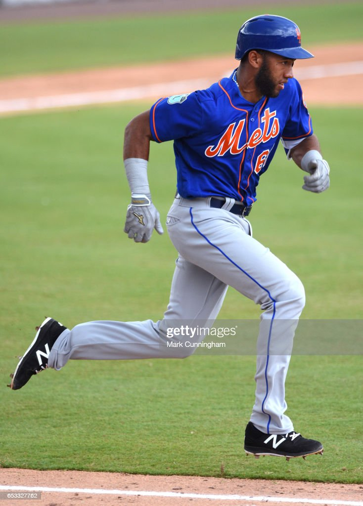 Amed Rosario #61 of the New York Mets runs to first base during the Spring Training game against the Detroit Tigers at Publix Field at Joker Marchant Stadium on March 12, 2017 in Lakeland, Florida. The Tigers defeated the Mets 4-3.