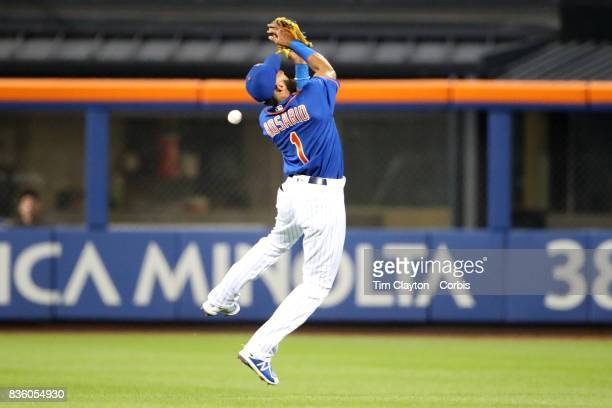 Amed Rosario of the New York Mets spills a pop up from Dee Gordon of the Miami Marlins in the sixth inning during the Miami Marlins Vs New York Mets...