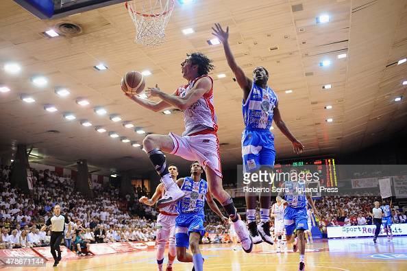 Amedeo Della Valle of Grissin Bon competes with Jerome Dyson of Banco di Sardegna during the match of LegaBasket Serie A playoff Final Game 7 between...
