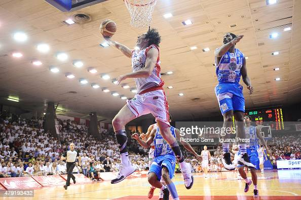 Amedeo Della Valle of Grissin Bon competes with Jerome Dyson of Banco di Sardegna during the match of LegaBasket Serie A game 7 of playoff's final...