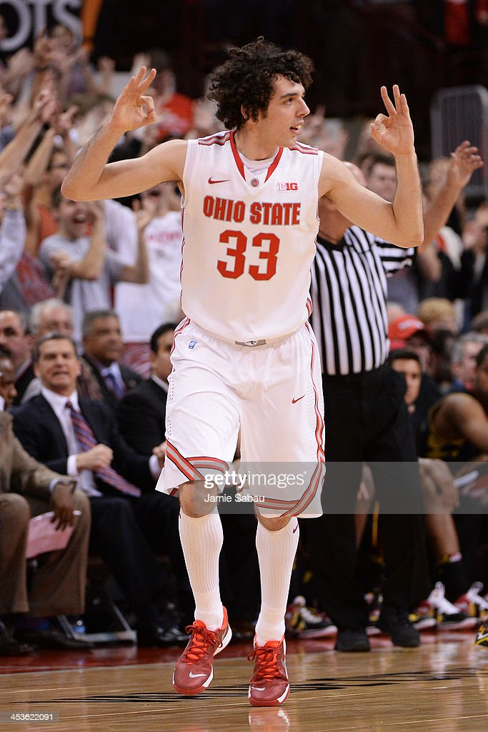 Amedeo Della Valle #33 of the Ohio State Buckeyes celebrates after sinking a three-point basket in the first half against the Maryland Terrapins on December 4, 2013 at Value City Arena in Columbus, Ohio. Ohio State defeated Maryland 76-60.