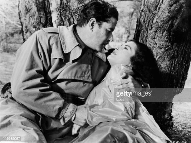 Amedeo Nazzari and Silvana Pampanini in a passionate embrace in a scene from the movie drama 'A Husband For Anna' directed by Giueseppe De Santis 1953