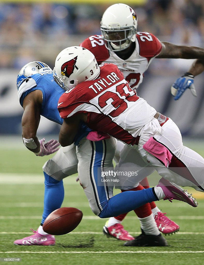 Ameer Abdullah #21 of the Detroit Lions fumbles the ball after being hit by Stepfan Taylor #30 of the Arizona Cardinals on October 11, 2015 at Ford Field in Detroit, Michigan. The Arizona Cardinals win 42-17 over the Detroit Lions.