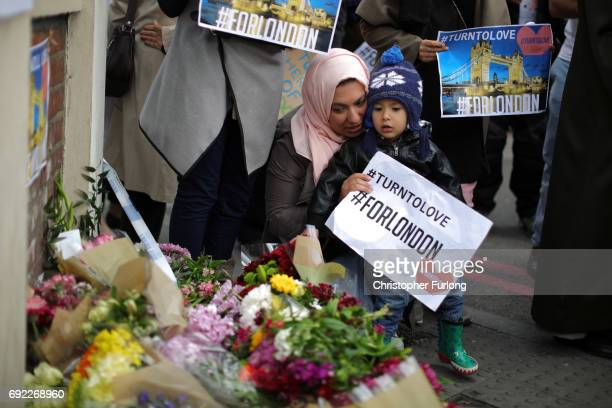 Ameer Hussein aged 2 lays flowers near the scene of last night's terrorist attack on June 4 2017 in London England Police continue to cordon off an...