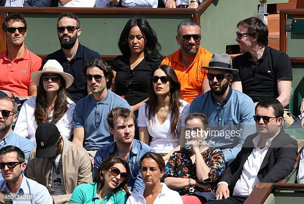 Amel Bent on top row below her Louise Monot and boyfriend Sofia Essaidi and boyfriend Adrien Galo attend Day 12 of the French Open 2014 held at...