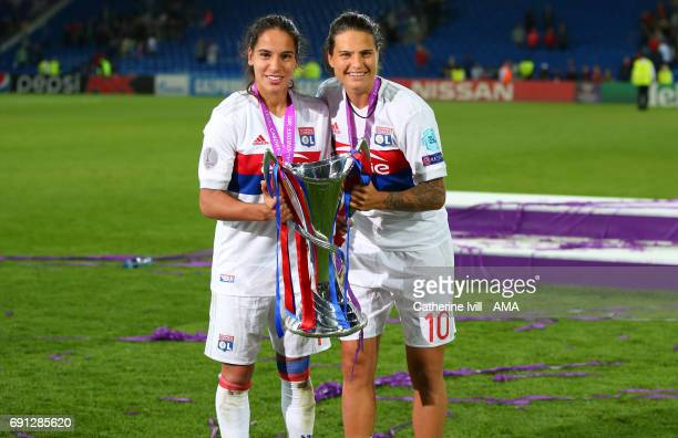 Amel Majri and Dzsenifer Marozsan of Olympique Lyonnais celebrate with the trophy during the UEFA Women's Champions League Final match between Lyon...