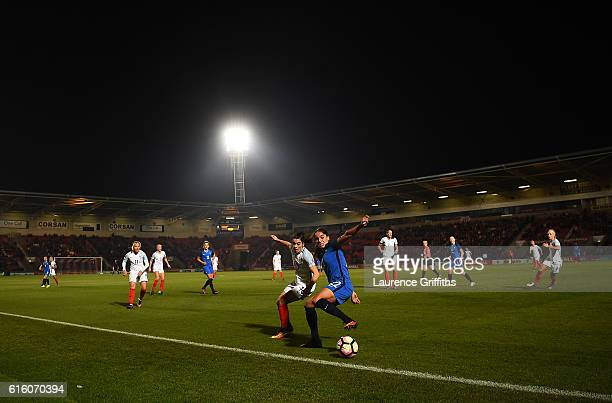 Amel Majri of France battles with Karen Carney of England during the International Friendly between England and France at Keepmoat Stadium on October...