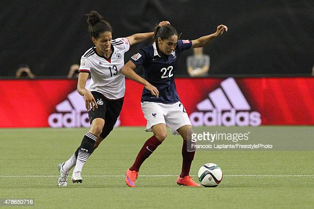Amel Majri of France controls the ball against Celia Sasic of Germany during the FIFA Women's World Cup Canada 2015 quarter final match between...