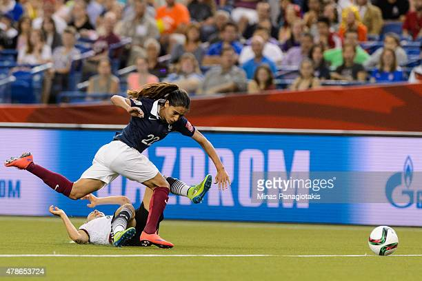 Amel Majri of France falls over Leonie Maier of Germany during the 2015 FIFA Women's World Cup quarter final match at Olympic Stadium on June 26 2015...
