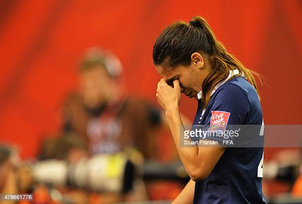 Amel Majri of France looks dejected after her team lost in a penalty shootout during the quarter final match of the FIFA Women's World Cup between...