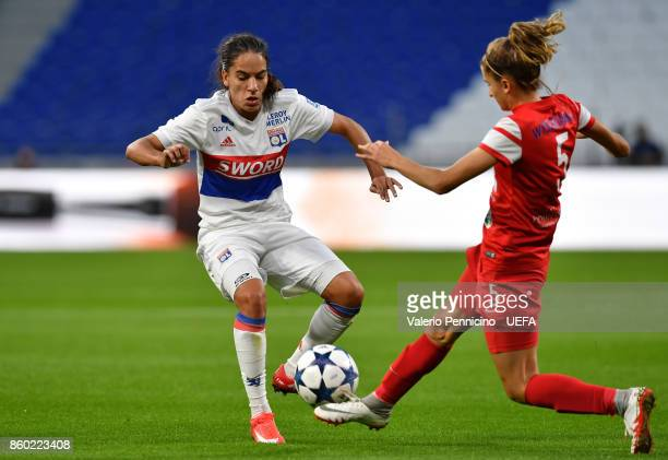 Amel Majri of Lyon is challenged by Nikol Kaletka of Medyk Konin during the UEFA Women's Champions League Round of 32 Second Leg match between Lyon...