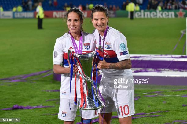 Amel Majri of Olympique Lyon and Dzsenifer Marozsn of Olympique Lyon celebrate with the Champions League trophy during the UEFA Women's Champions...